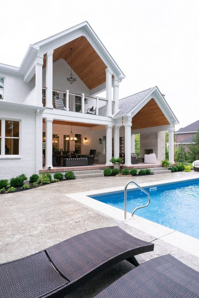 Two-level back deck overlooking pool of custom build home in Bloomington IN